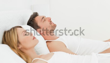 Bonitinho homem beijando esposa bochecha sala de estar Foto stock © wavebreak_media