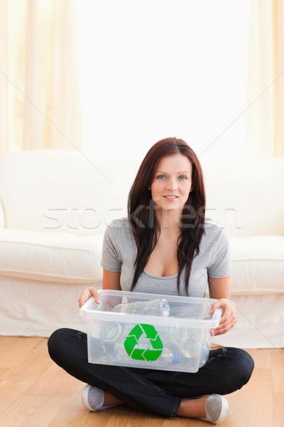 Oturma kadın geri dönüşüm oturma odası Stok fotoğraf © wavebreak_media