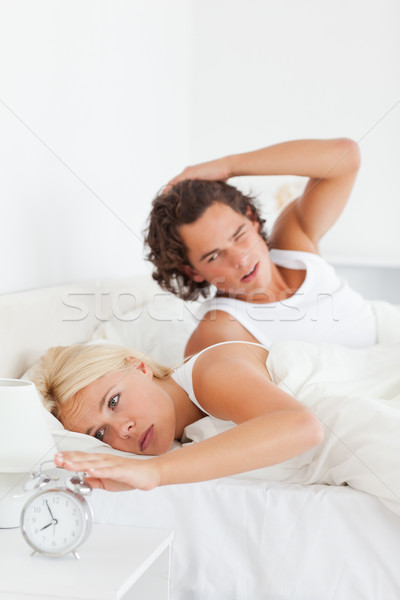Portrait of a tired couple waking up in their bedroom Stock photo © wavebreak_media
