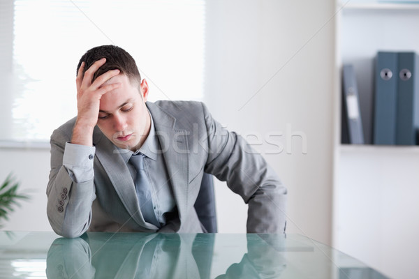 Businessman got bad news and is sitting behind a table Stock photo © wavebreak_media