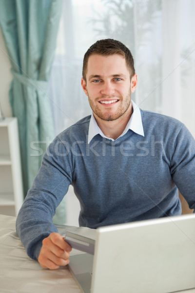 Smiling young male happy about his online shopping Stock photo © wavebreak_media