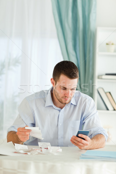 Young businessman doing bookkeeping Stock photo © wavebreak_media