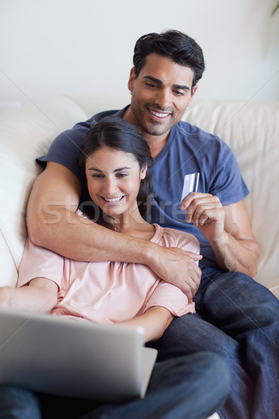 Portrait of a couple booking their holidays online in their living room Stock photo © wavebreak_media