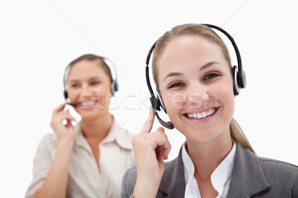 Happy operators using headsets against a white background Stock photo © wavebreak_media