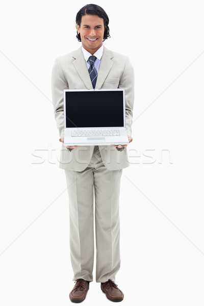 Portrait of a smiling businessman showing a notebook against a white background Stock photo © wavebreak_media