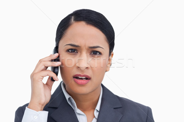 Close up of saleswoman getting bad news from caller against a white background Stock photo © wavebreak_media