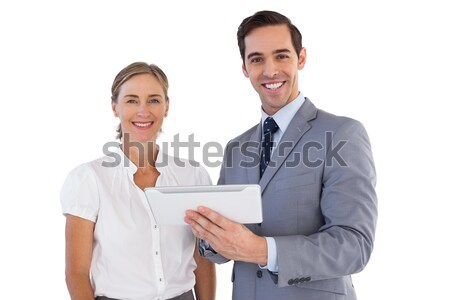 Smiling salesteam giving approval against a white background Stock photo © wavebreak_media