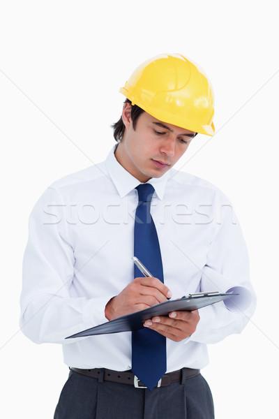 Close up of male architect taking notes against a white background Stock photo © wavebreak_media
