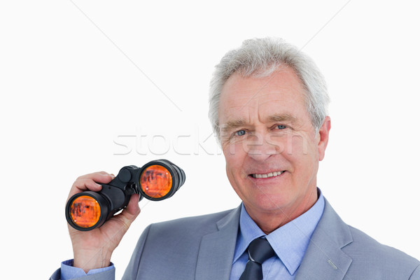 Close up of smiling mature tradesman with spy glass against a white background Stock photo © wavebreak_media