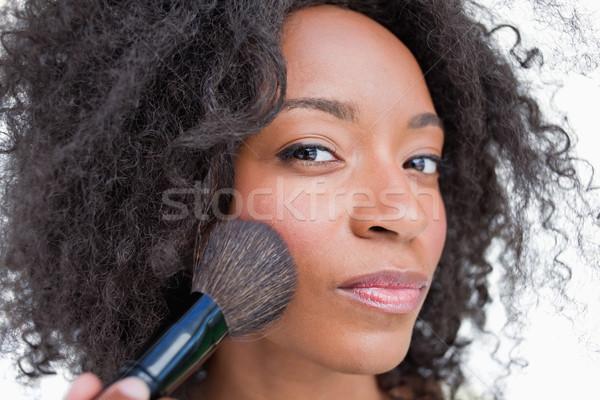 Fiatal komoly nő jelentkezik bőrpír por Stock fotó © wavebreak_media
