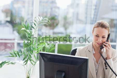 Woman working on a computer with city view in background  Stock photo © wavebreak_media