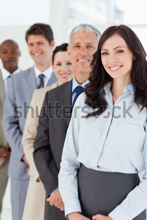 Confident and mature manager standing among his smiling employees Stock photo © wavebreak_media