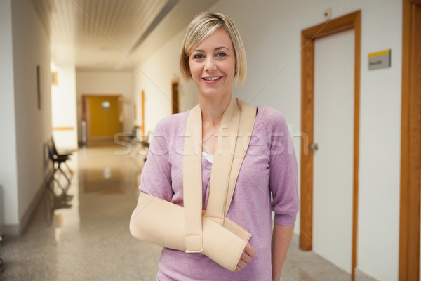 Patient with broken arm in sling in hospital corridor Stock photo © wavebreak_media