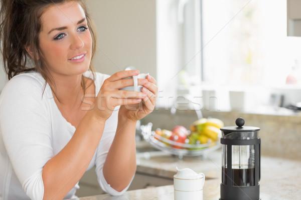 Woman thinking over coffee at breakfast in kitchen Stock photo © wavebreak_media