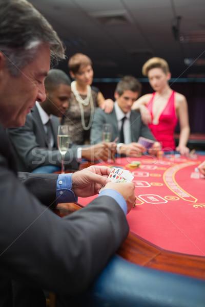 люди играет покер таблице казино стороны Сток-фото © wavebreak_media