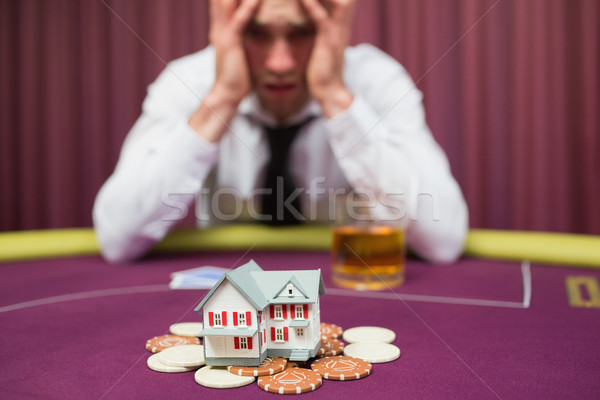 Man is betting his house at poker game in casino Stock photo © wavebreak_media