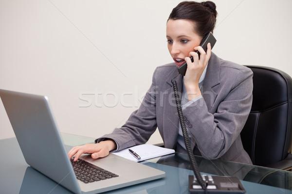 ビジネス女性 ラップトップを使用して コール 小さな オフィス ストックフォト © wavebreak_media