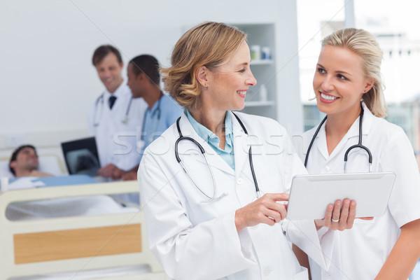 улыбаясь врачи говорить другой больницу комнату Сток-фото © wavebreak_media