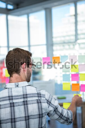 Woman drawing on flowchart with sticky notes Stock photo © wavebreak_media