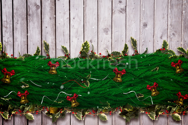 Composite image of fir branch christmas decoration garland Stock photo © wavebreak_media
