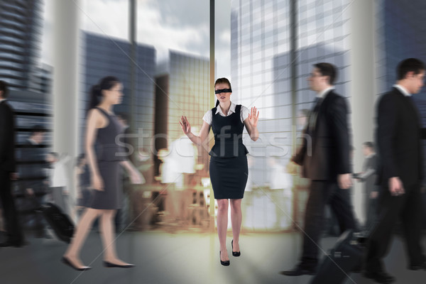 Composite image of redhead businesswoman in a blindfold Stock photo © wavebreak_media