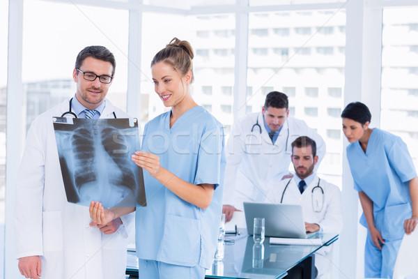 врачи Xray коллеги используя ноутбук за Сток-фото © wavebreak_media