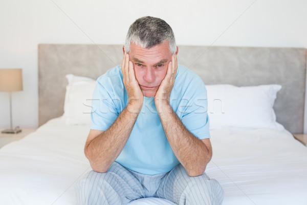 Sad senior man sitting on bed Stock photo © wavebreak_media