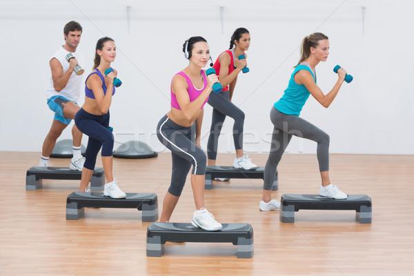 Fitness klasy krok aerobik wykonywania Zdjęcia stock © wavebreak_media