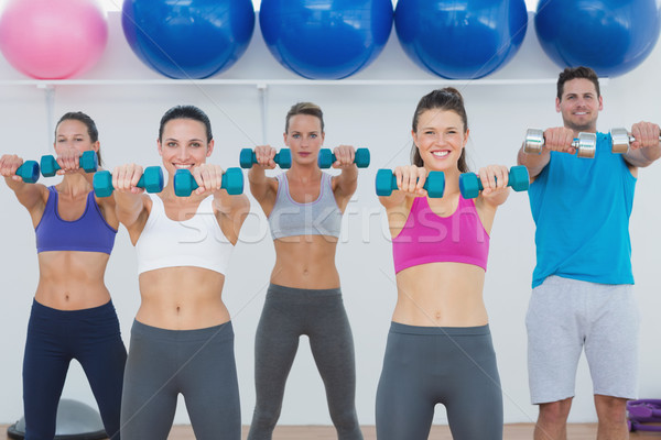 Uygunluk sınıf egzersiz dambıl spor salonu portre Stok fotoğraf © wavebreak_media