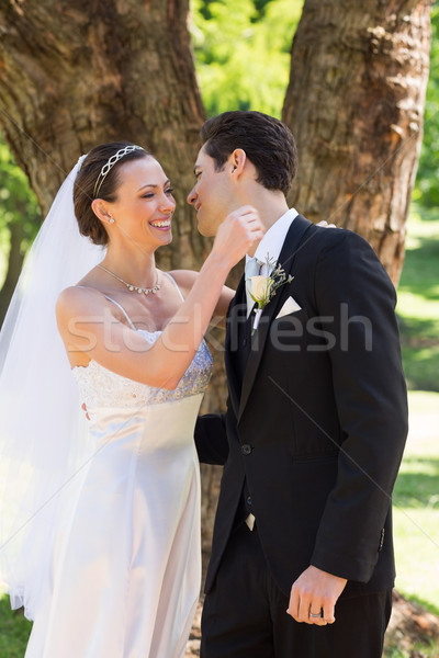 Newly wed couple about to hug in garden Stock photo © wavebreak_media