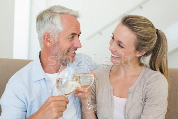 Szczęśliwy para posiedzenia kanapie białe wino Zdjęcia stock © wavebreak_media