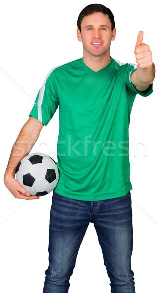 Guapo fútbol ventilador verde blanco hombre Foto stock © wavebreak_media