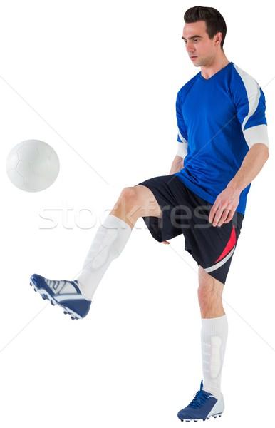 Football player in blue kicking ball Stock photo © wavebreak_media