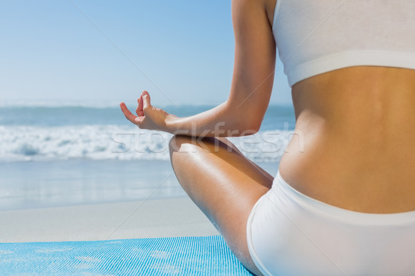 Fitt nő ül lótusz póz tengerpart Stock fotó © wavebreak_media