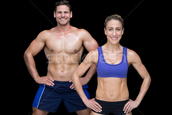 Crossfit couple smiling at camera with hands on hips Stock photo © wavebreak_media