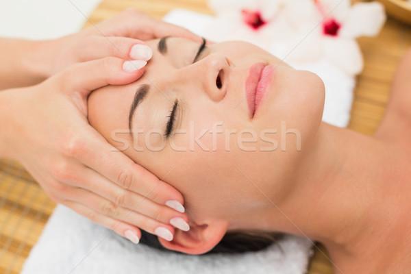 Smiling brunette enjoying a head massage Stock photo © wavebreak_media