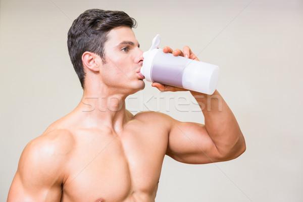 Moço potável proteína branco Foto stock © wavebreak_media