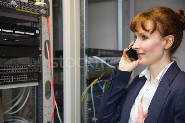 Bastante computador técnico falante telefone Foto stock © wavebreak_media