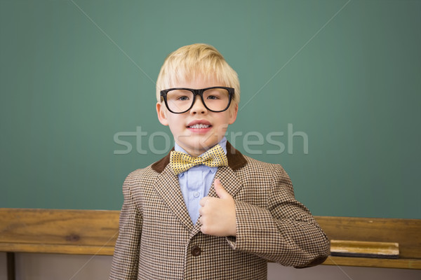 Cute pupil dressed up as teacher in classroom Stock photo © wavebreak_media