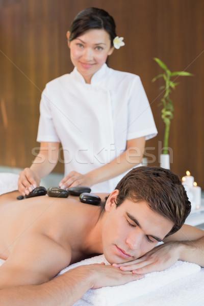 Stock photo: Man receiving stone massage at spa center