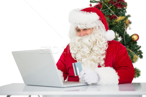 Father christmas shopping online with laptop Stock photo © wavebreak_media