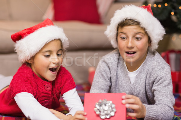 Shocked brother and sister opening a gift Stock photo © wavebreak_media