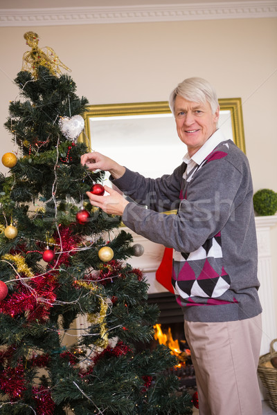 Senior man decorating the christmas tree Stock photo © wavebreak_media
