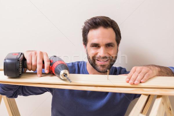 Casuale uomo perforazione chiodo home Foto d'archivio © wavebreak_media