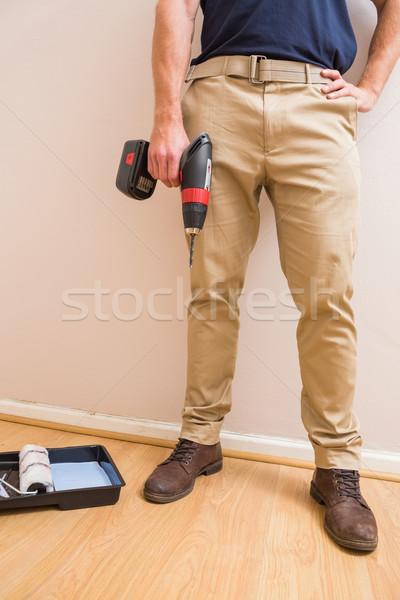 Construction worker holding power tool Stock photo © wavebreak_media