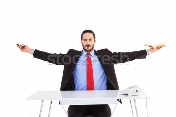 Unsmiling businessman sitting with arms outstretched Stock photo © wavebreak_media