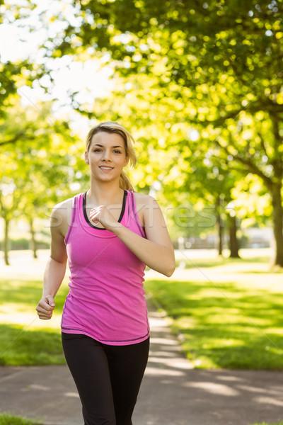 Fit blonde jogging in the park Stock photo © wavebreak_media
