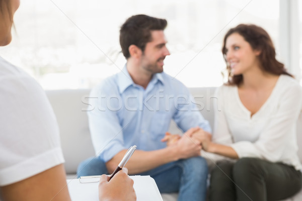 Reconciled couple smiling at each other Stock photo © wavebreak_media