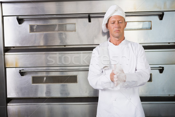 Baker farine mains cuisine boulangerie Photo stock © wavebreak_media