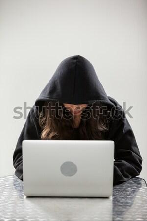 Hacker kapucnis laptopot használ fehér technológia notebook Stock fotó © wavebreak_media